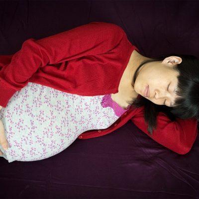 Pregnant woman laid down