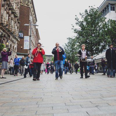 Marching band walking down street
