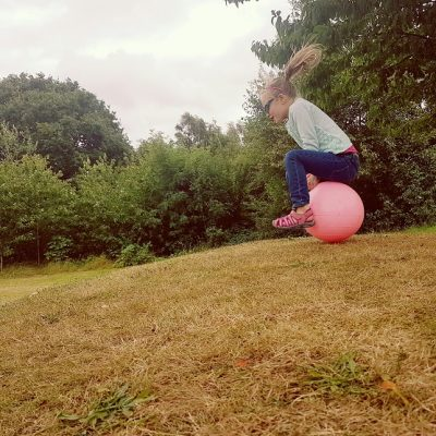 Young girl on space hopper