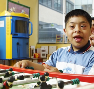 Young boy playing table football