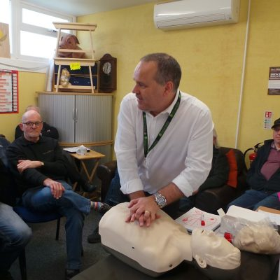 Man giving first aid training