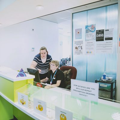 Receptionist speaking with colleague