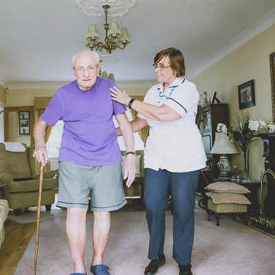 Carer helping patient