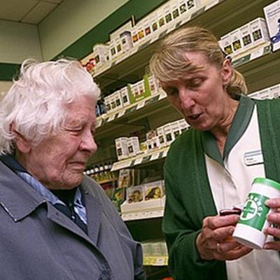 Pharmacist helping eldery lady